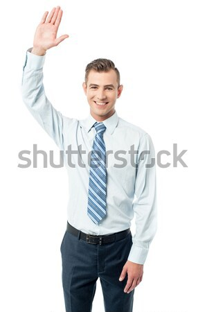 Business execuitve raising his hand Stock photo © stockyimages