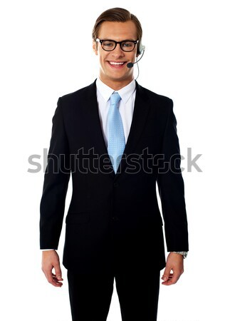 Male telemarketer posing in headsets, smiling Stock photo © stockyimages