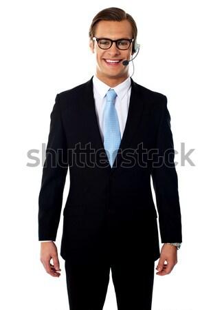 Mannelijke poseren glimlachend ale geïsoleerd witte Stockfoto © stockyimages