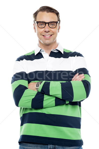 Confident smiling young chap with spectacles Stock photo © stockyimages