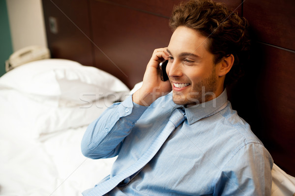 Young man conversing on mobile phone Stock photo © stockyimages
