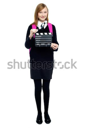 Cute school girl with a clapperboard Stock photo © stockyimages