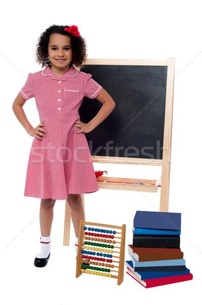 улыбаясь девочку школьную форму довольно школы ребенка Сток-фото © stockyimages