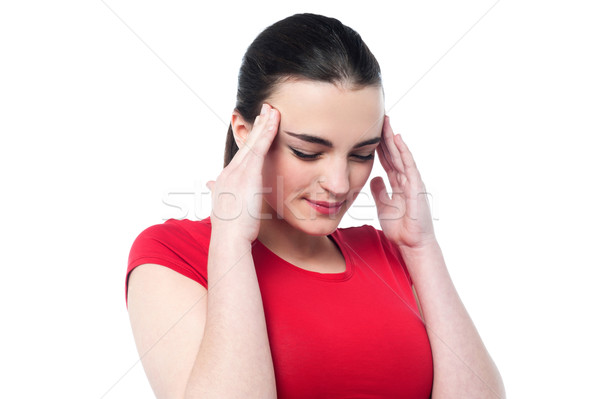 Young girl having serious headache Stock photo © stockyimages