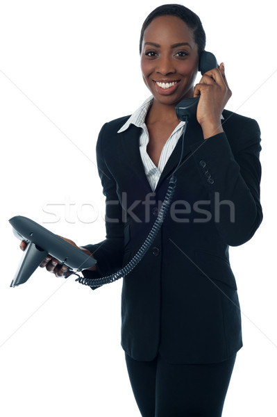 Cheerful lady attending clients call Stock photo © stockyimages