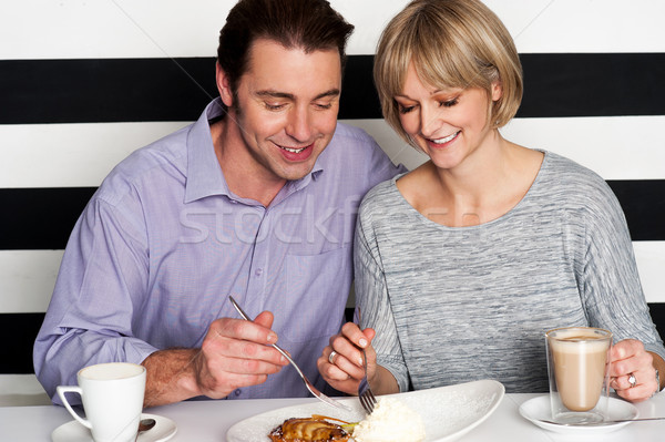 Beautiful couple having morning meal together Stock photo © stockyimages