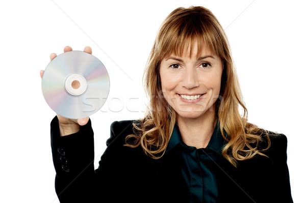Női menedzser mutat CD hölgy igazgató Stock fotó © stockyimages