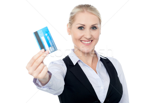 Smart business lady holding credit card Stock photo © stockyimages