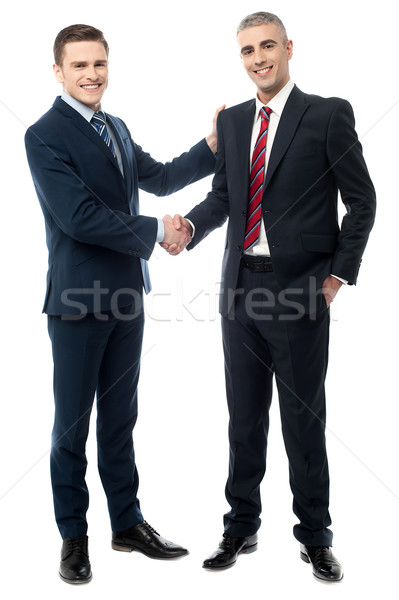 Successful businessmen shaking hands Stock photo © stockyimages