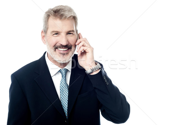 Happy mature man talking on cell phone Stock photo © stockyimages