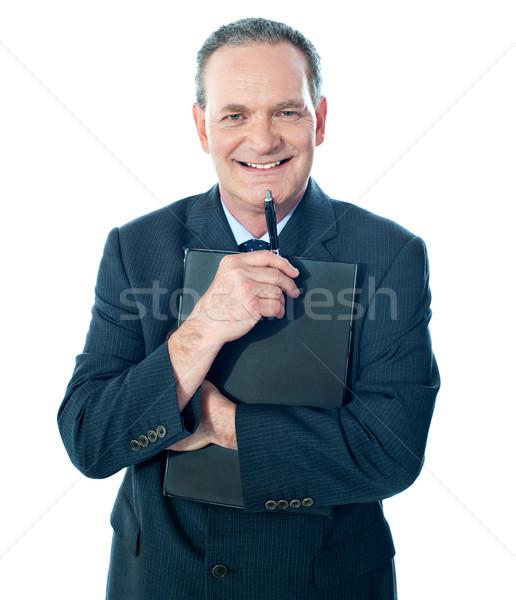 Entreprise personne document souriant caméra Photo stock © stockyimages