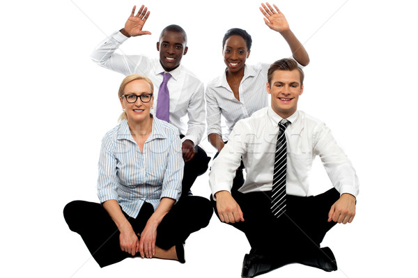 Happy business group demonstrating partnership Stock photo © stockyimages