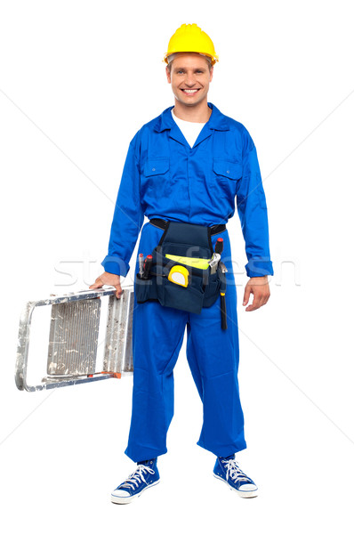 Construction worker ready with stepladder Stock photo © stockyimages
