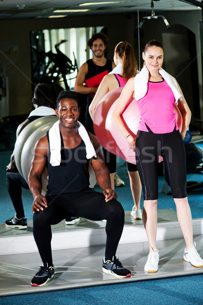 Gym clients working out with the exercise ball Stock photo © stockyimages
