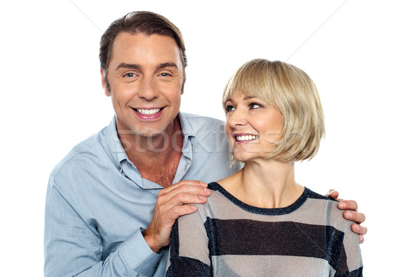 Romantic lady admiring her smart looking husband Stock photo © stockyimages