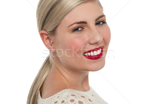 Charming teen model flashing toothy smile Stock photo © stockyimages