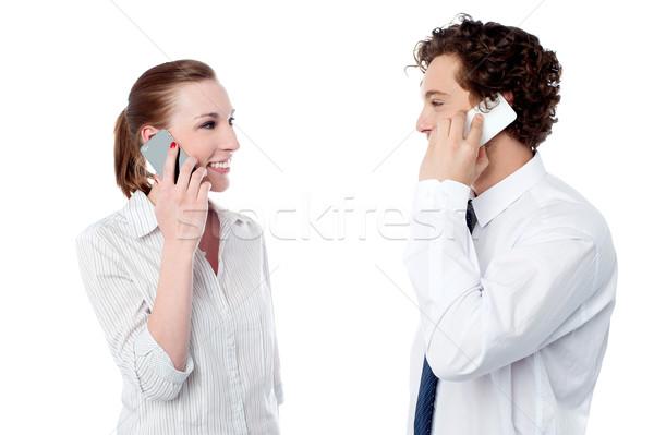 Bureau engagé coup de téléphone jeunes collègues Photo stock © stockyimages