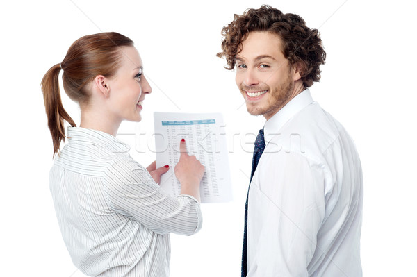 Lady pointing at statistics given on report Stock photo © stockyimages