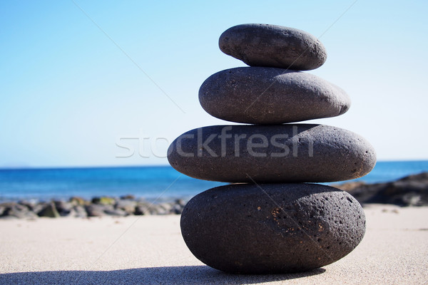 Stack of zen stones on the sand Stock photo © stockyimages