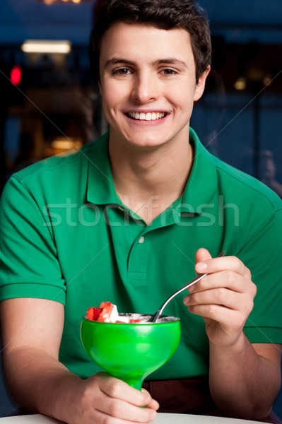 Young chap eating ice cream Stock photo © stockyimages