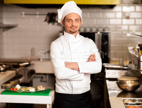 Confident young chef posing Stock photo © stockyimages