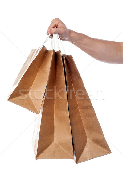 Male hand holding shopping bags Stock photo © stockyimages