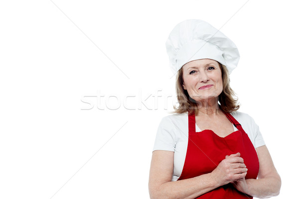 Portrait of a smiling female chef, hands clasped Stock photo © stockyimages