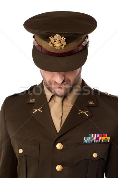 Esercito uomo guardando verso il basso ufficiale arco giù Foto d'archivio © stockyimages