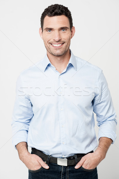Handsome smiling man posing in casuals Stock photo © stockyimages