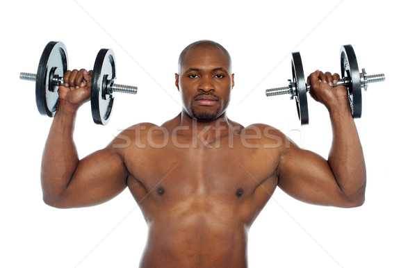 Torse nu africaine Homme haltères épaules Photo stock © stockyimages