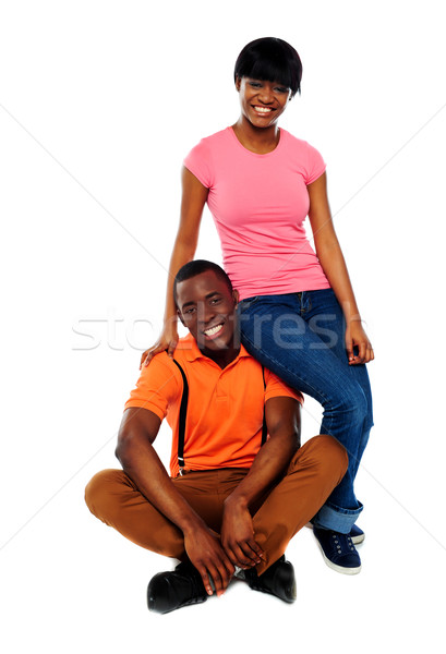 Woman in casuals sitting on mans shoulder Stock photo © stockyimages