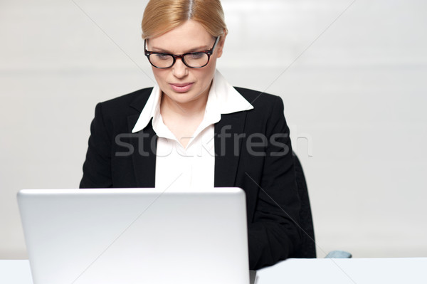 Corporate lady working on laptop Stock photo © stockyimages