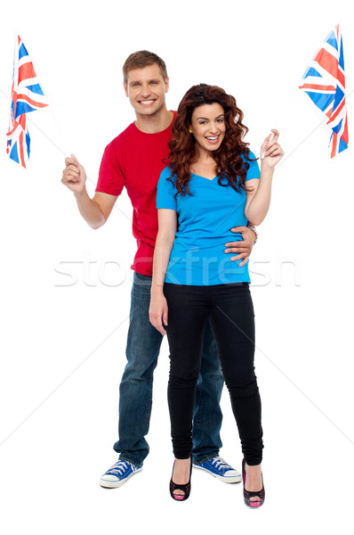 Cheerful UK supporters posing together Stock photo © stockyimages