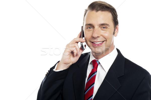 Corporate männlich Berater sprechen Mobiltelefon Stock foto © stockyimages