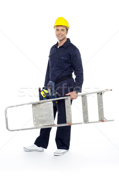 Repairman holding stepladder, ready to go to work Stock photo © stockyimages