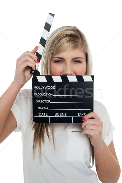 Beautiful female with clapperboard. It's showtime. Stock photo © stockyimages
