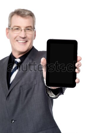 Corporate lady working on tablet device Stock photo © stockyimages