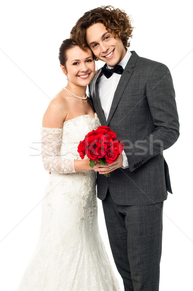 Beautiful new bridegroom smiles for the camera Stock photo © stockyimages