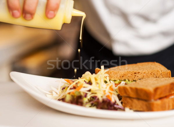 Mayonnaise sauce poured on a vegetable salad Stock photo © stockyimages