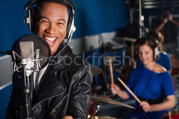 Singer recording a song in studio Stock photo © stockyimages