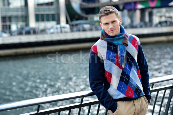 Handsome man posing near reiver railing Stock photo © stockyimages