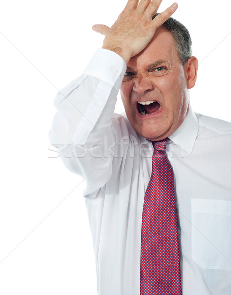 Cropped image of a disturbed businessman Stock photo © stockyimages