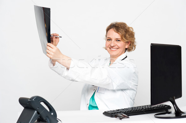 Surgeon pointing at diseased area with pen Stock photo © stockyimages