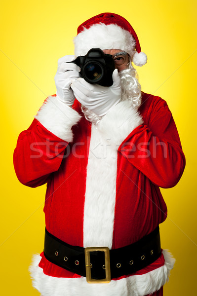 Smile please! Santa capturing a perfect frame Stock photo © stockyimages