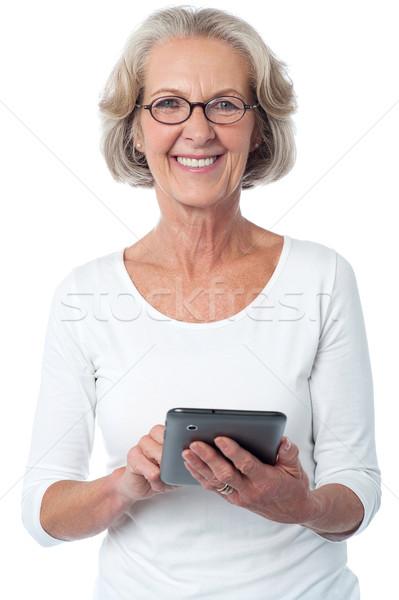 Kobieta kontakcie urządzenie senior stwarzające Zdjęcia stock © stockyimages