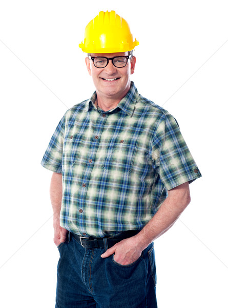 Smiling matured architect posing Stock photo © stockyimages