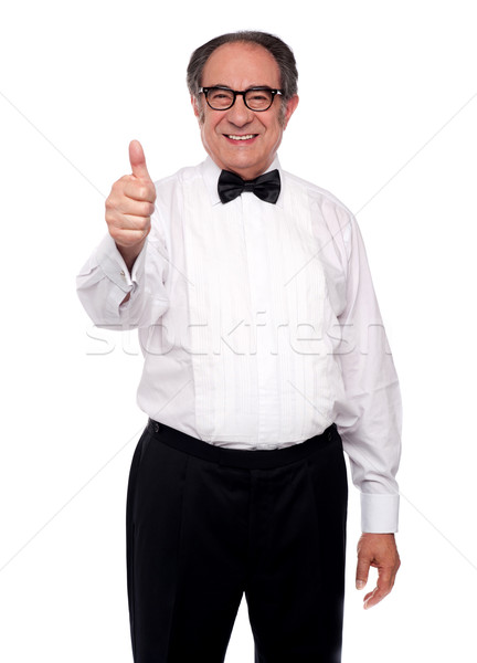 Matured man showing thumbs up Stock photo © stockyimages