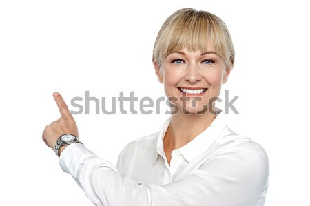 Corporate lady pointing backwards Stock photo © stockyimages