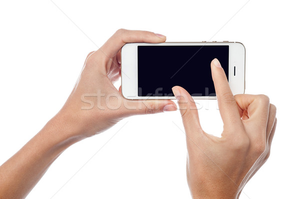 Fingers zooming in on cell phone Stock photo © stockyimages