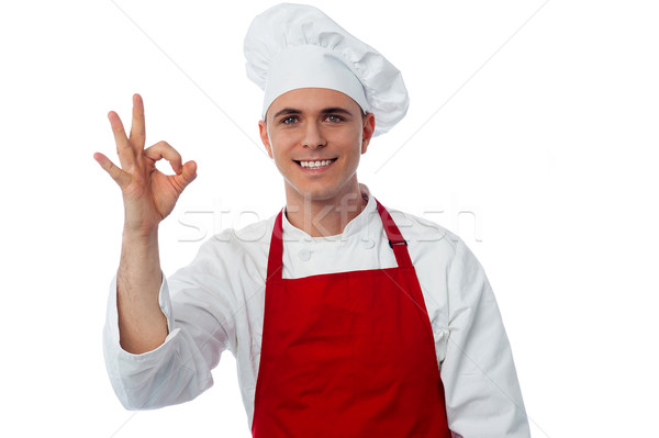 Smiling male chef showing ok sign Stock photo © stockyimages